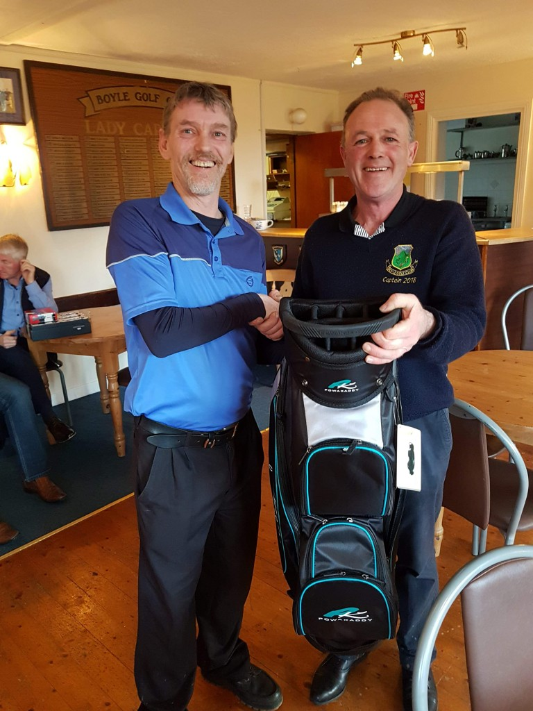 Winner of the Golfstyle Strokeplay Gerry O'Hara receiving his prize from Captain Terry Canning